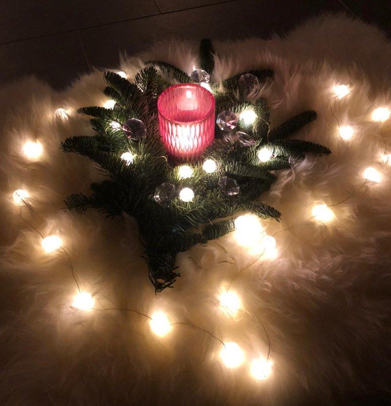 Winterliche Kerzen mit Tannenzweigen